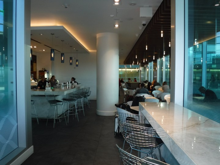 The bar and seating area in the American Express Centurion Lounge in DFW Terminal D.