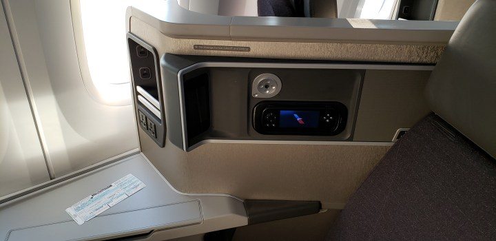 Electronic controls and storage on the American Airlines Boeing 787 in the premium cabin.