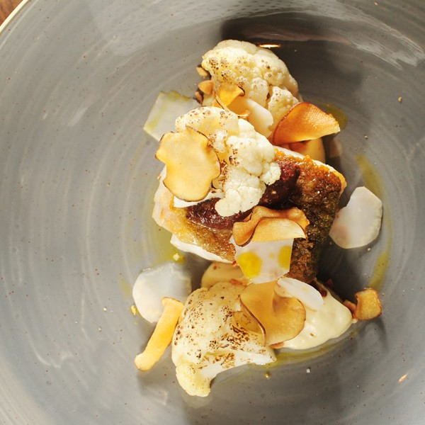 North Atlantic cod, cauliflower puree, caramelised florets, coconib pesto, candied hazelnut, Jerusalem artichoke