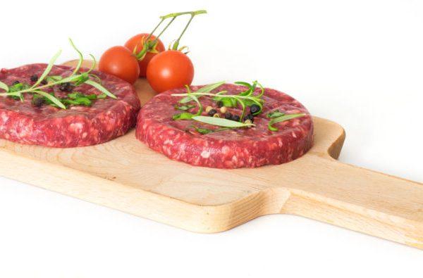 Raw beef hambuger isolated on white background