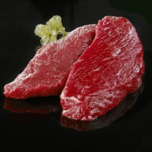 Raw ostrich steaks