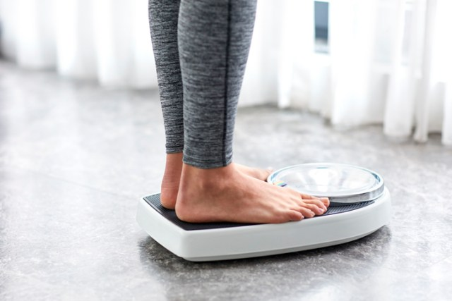 person on bathroom scale