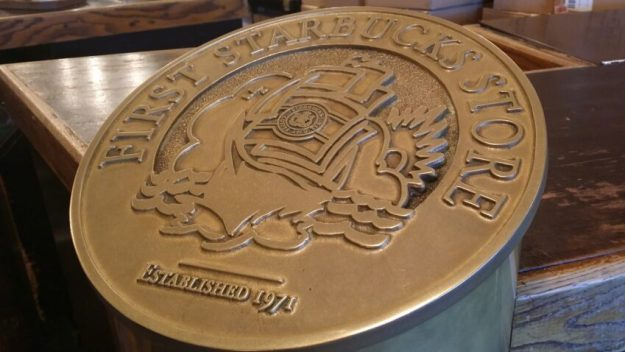 plaque at original starbucks in Seattle, WA