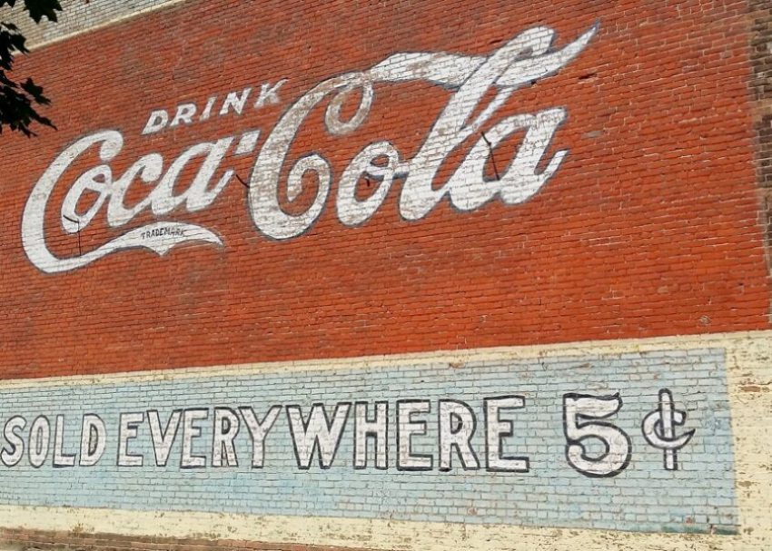 Coca-Cola mural painted on outside of Curiosi-Tea