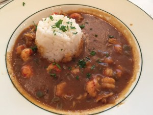 crawfish Etouffee: Louisiana crawfish, shellfish stock, trinity, green onions, light brown roux, steamed rice