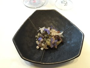 Abalone, black soy beans, nori brown butter, heart of palm, Bachelor button flowers and puffed rice
