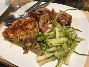 Artichoke pie, puntarelle and rabbit stuffed with porchetta and liver