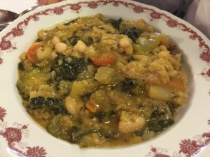 Ribollita: soup with bread, beans, carrots, potatoes, celery and kale