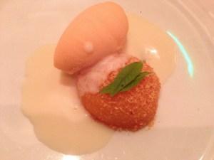 Poached peach and peach sorbet with verbena and almond milk ganache