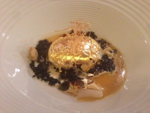 The garden of the goose that laid the golden egg: low temperature cooked egg, poultry juice, crunchy dark bread with cuttlefish ink, crispy fried leek
