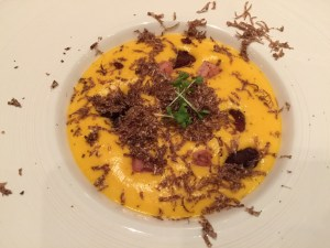 Red pumpkin mousse with caramelized chestnuts, cured port and fresh black truffles