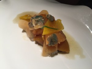 Peppers and melon with olive herb and venus clams