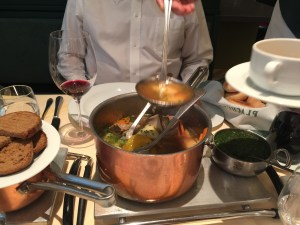 Start with a ladleful of beef broth from the pot into your bowl