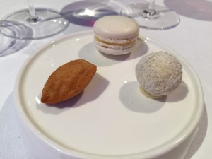 Madeleine with cinnamon, macaron with passionfruit, white chocolate truffle with lavender