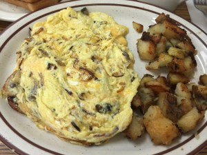 Soft scrambled eggs with mushrooms, cheese and onions & potatoes
