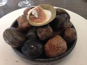 200 year old mussel, sliced. Seaweed powder on rim of shell.