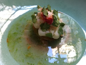 Lobster served with foie gras, sweet cream and coconut bullion