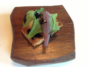 Grilled toast of bone marrow with herbs and horseradish ash
