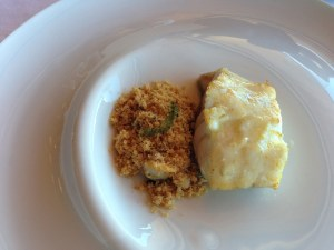 Grouper with cous cous with cokles and the foam of the waves as a sauce
