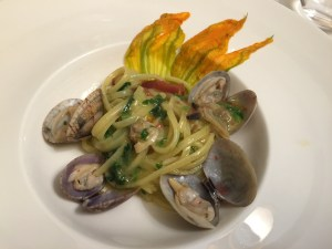 Pasta with two types of clams, one from the Lagoon and one from the sea, with squash blossoms and sun-dried tomatoes