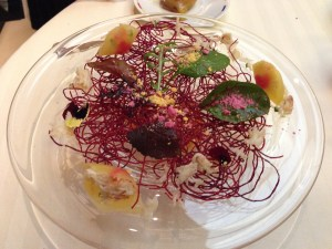 beet root mouse with crab meat, iced carrot, beet root powder. Lobster and carrot consomme underneath beat nest