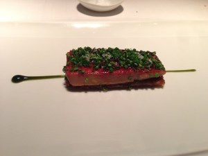 "Caramelized foie gras ""coca"" on pastry crust with chive arrop and leeks"