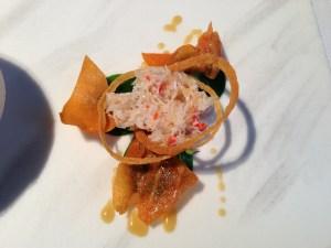 Salad garnished with fresh spider crab.