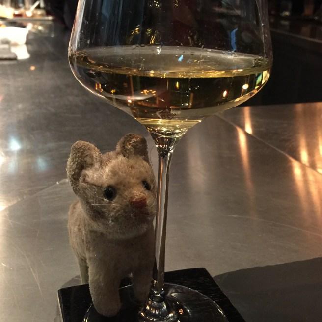 Frankie admires the wine