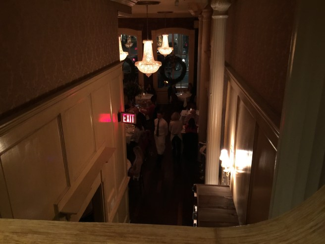 looking down at the entrance from the upstairs bathroom area