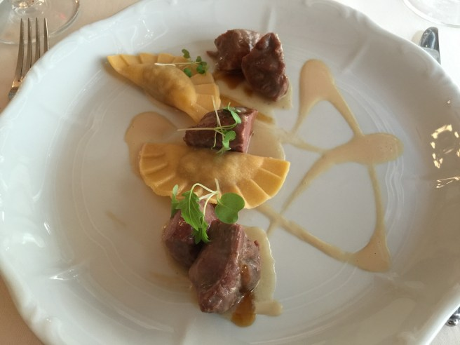 Mangalica pork cheeks with cabbage ravioli and foie gras veloute´