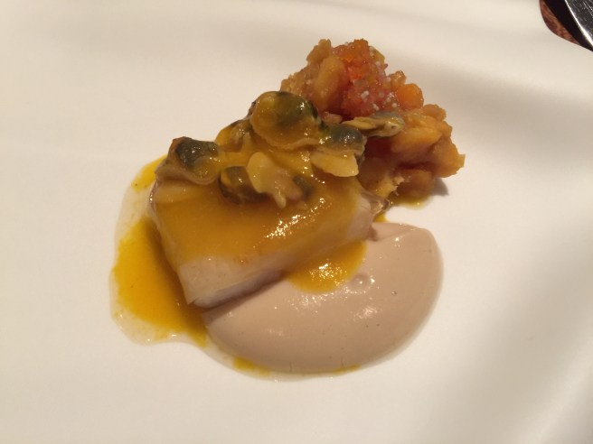 Catch of the day, corn cream, vongoles juice, sweet potatoes, ham broth veil