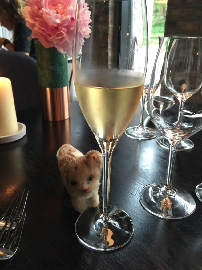 Frankie enjoys champagne