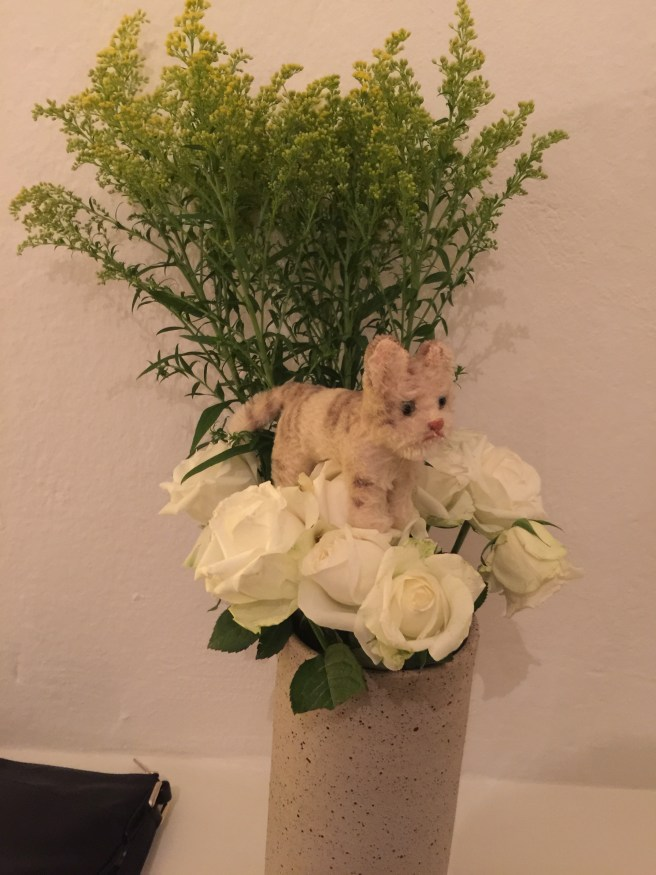 She couldn't have the flowers that close without climbing into