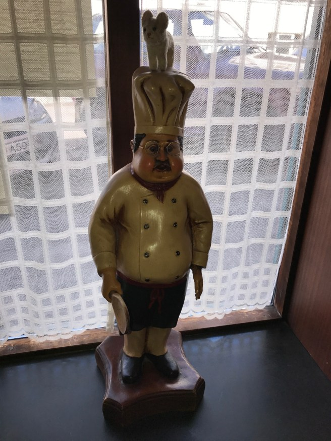 Frankie made friends with a little chef statue