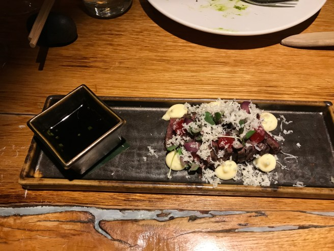 Robata grilled minke whale with horseradish and redcurrant served with soya ginger sauce