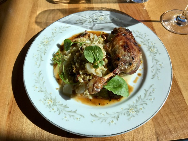 Duck confit with farro, chanterelle mushrooms, cippolini onions and cress