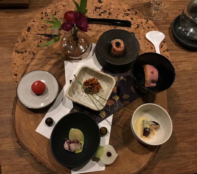 (Clockwise starting at 12:00): beef tartar with gel and caviar; duck wtih yuzu and marinated nettle; fig with miso milk and pinenuts; octopus with avocao and Japanese turnip; tomato with wasabi; (center) candied walnut