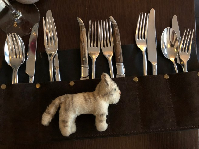 Frankie tried to blend in with the flatware holder