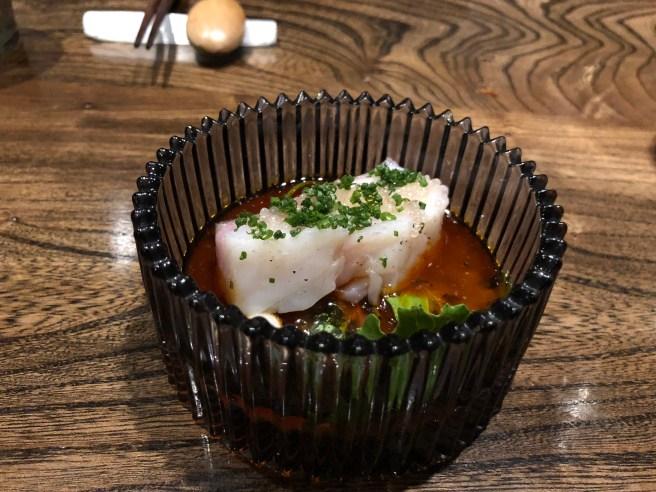 Monterrey black cod in lobster broth with espellet pepper
