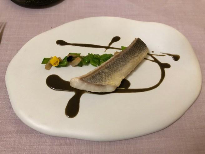 Sea bass, snow peas, pork dewlap and squid ink