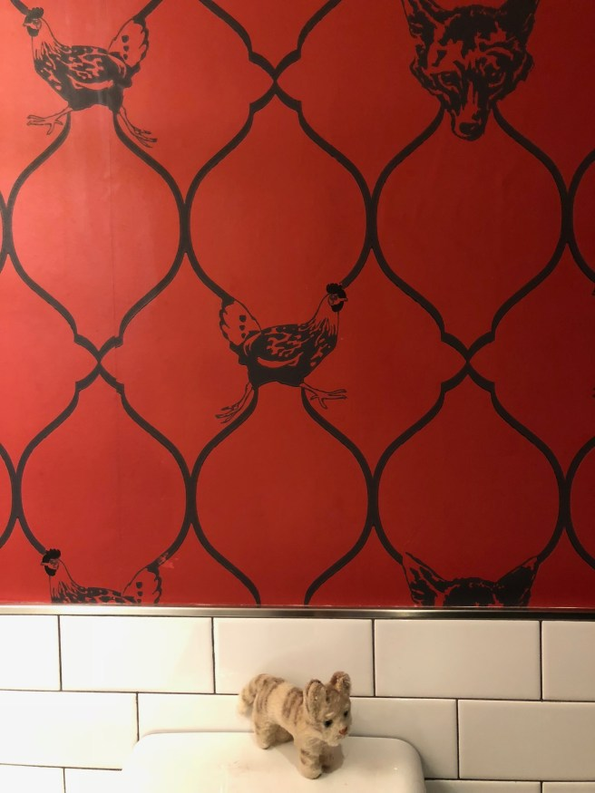 Frankie liked the chicken wallpaper in the bathroom