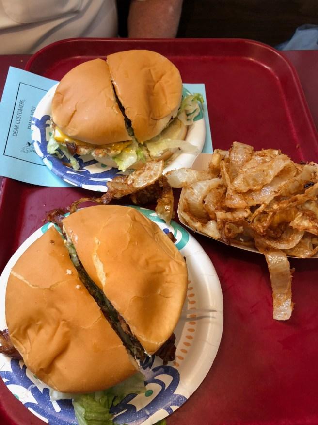 bacon cheeseburger and fish burger, onions