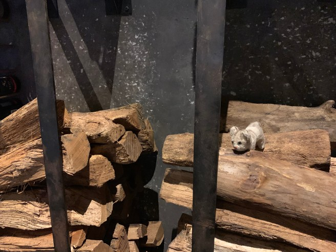 Frankie tred clawing the wood pile