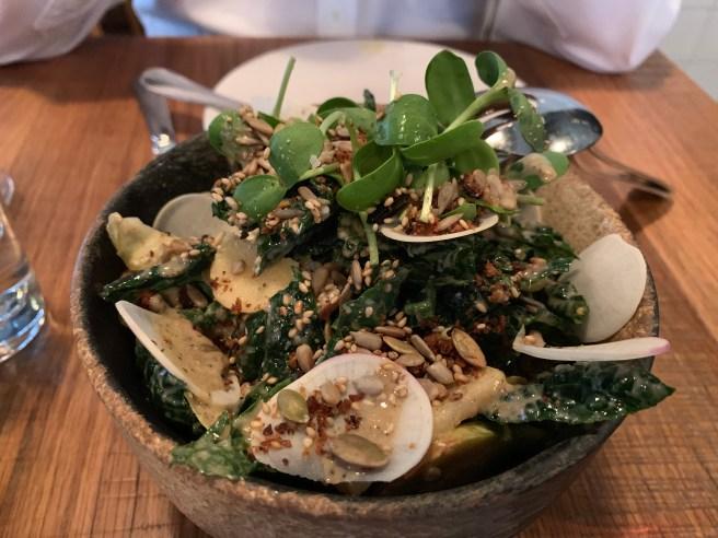 Tuscan Kale Salad, charred onion tahini vin, apple, endive, feta, seeded rye bread, toasted seeds