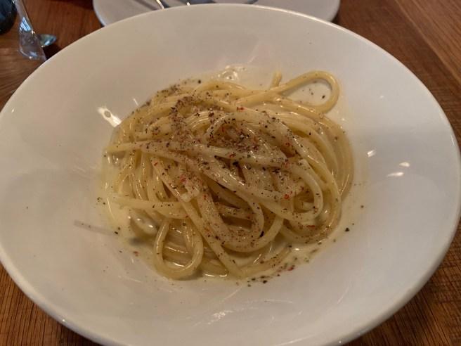 Cacio Whey Pepe, Mancini bucatini, pecorino Romano, ricotta whey, four peppercorn blend