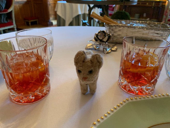 Frankie and a pair of Negroni cocktails
