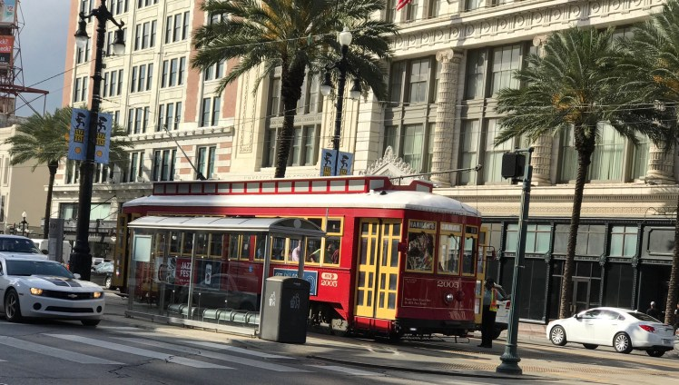 Canal Street in New Orleans can be explored riding a streetcar