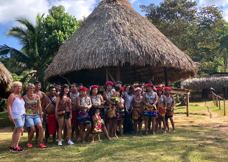 Embera tribal members posing with visitors