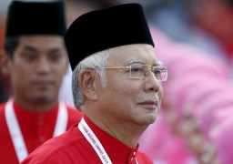 Malaysia's Prime Minister Najib Razak inspects the United Malays National Organisation (UMNO) youth during the annual assembly in Kuala Lumpur