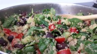 Cooking the quinoa salad stuffing for the Stuffed Peppers